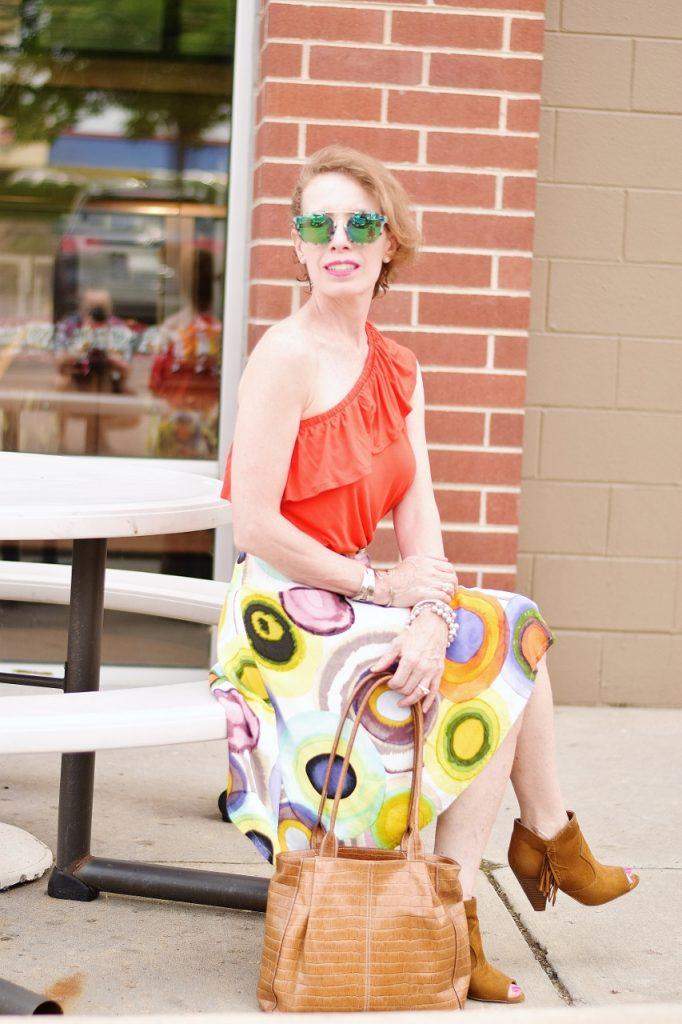 50+ Women wearing booties to transition summer skirts