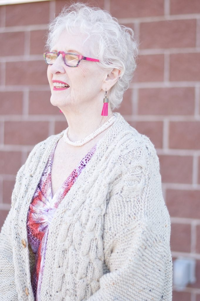 handknit sweater and booties for older women