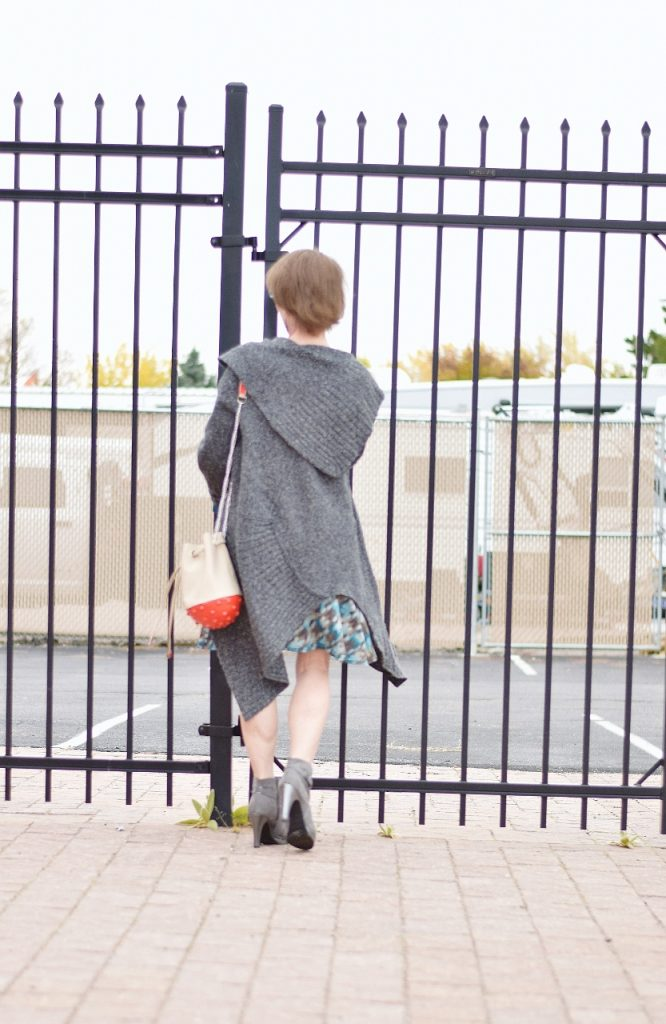 Women over 50 styling sweater and booties