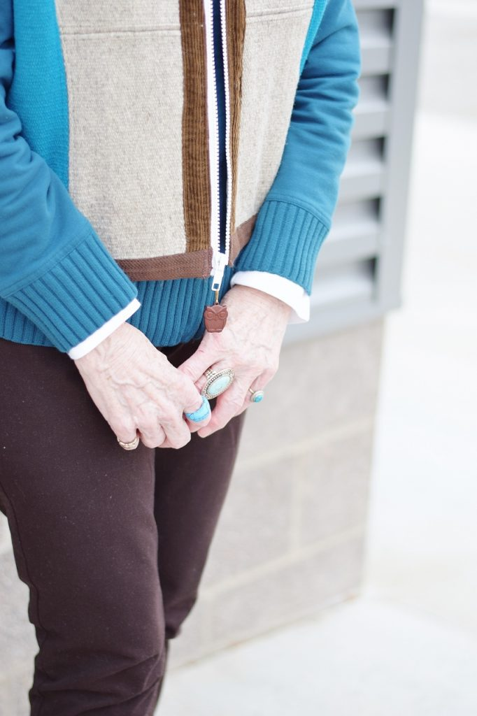 Layering a short vest with owl details