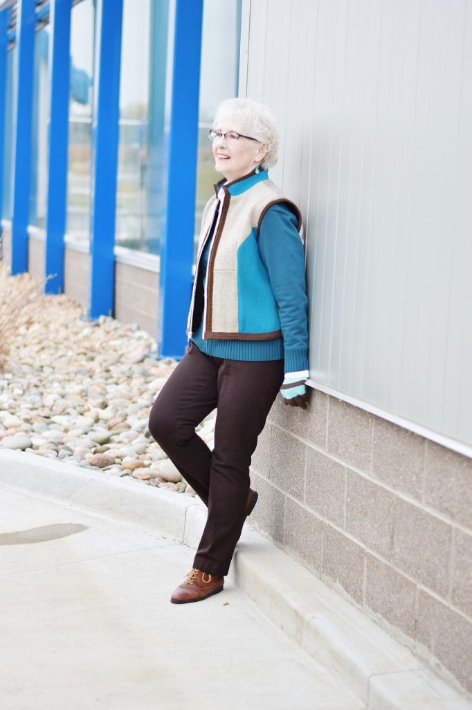 Layering a short vest over a short jacket for women above 70