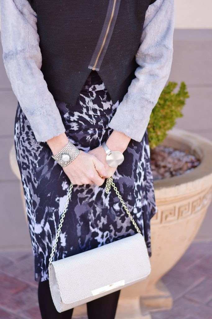 Layering a short vest with a dress underneath