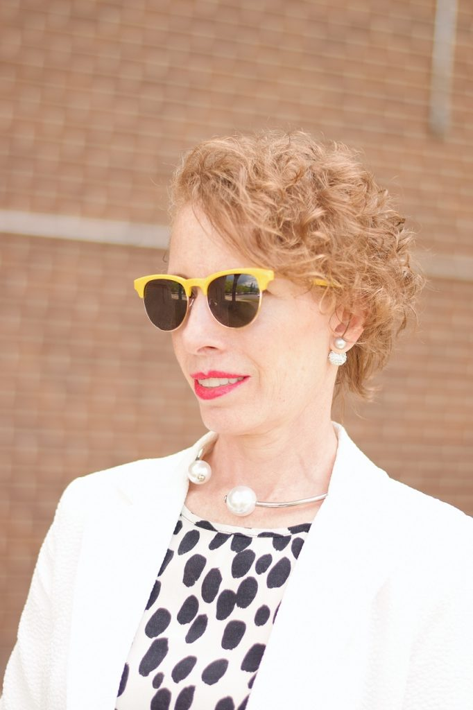 Dress up for Women over 50 with white blazer & pearl necklace