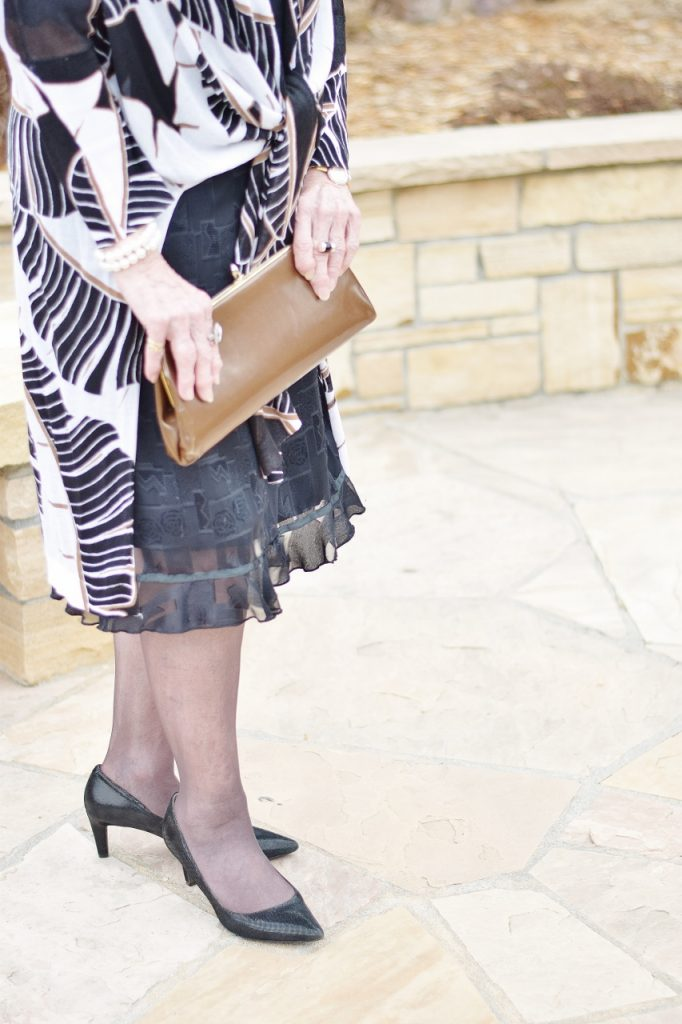 Little Black Dress for the Spring worn with black hosiery