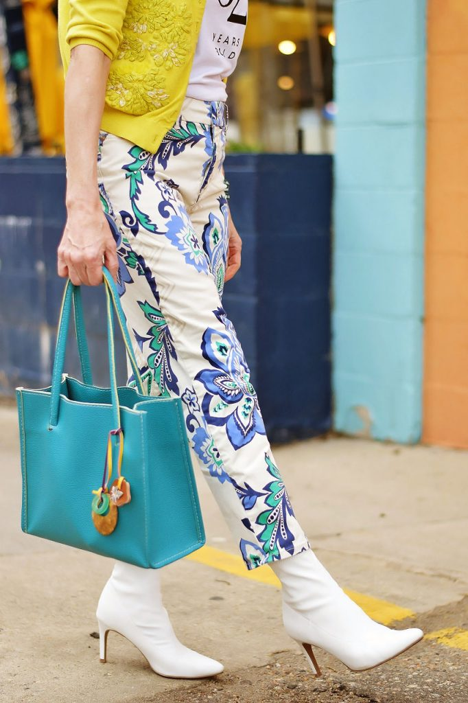Wearing yellow items as a pop of color with blues and whites
