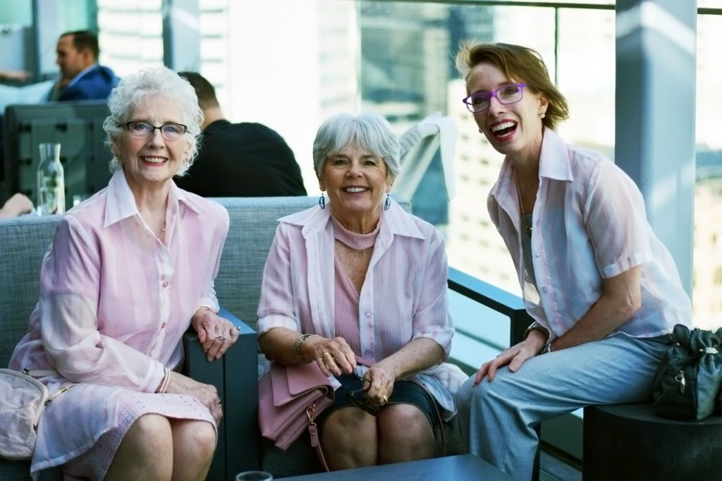 3 decades of women wearing sheer pink tops in Denver