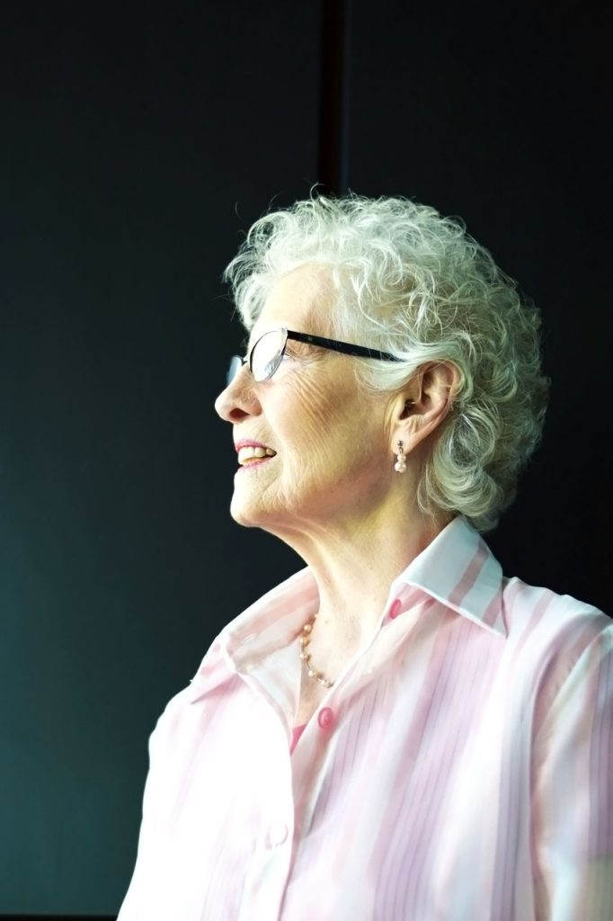 wearing a sheer pink top for women over 80