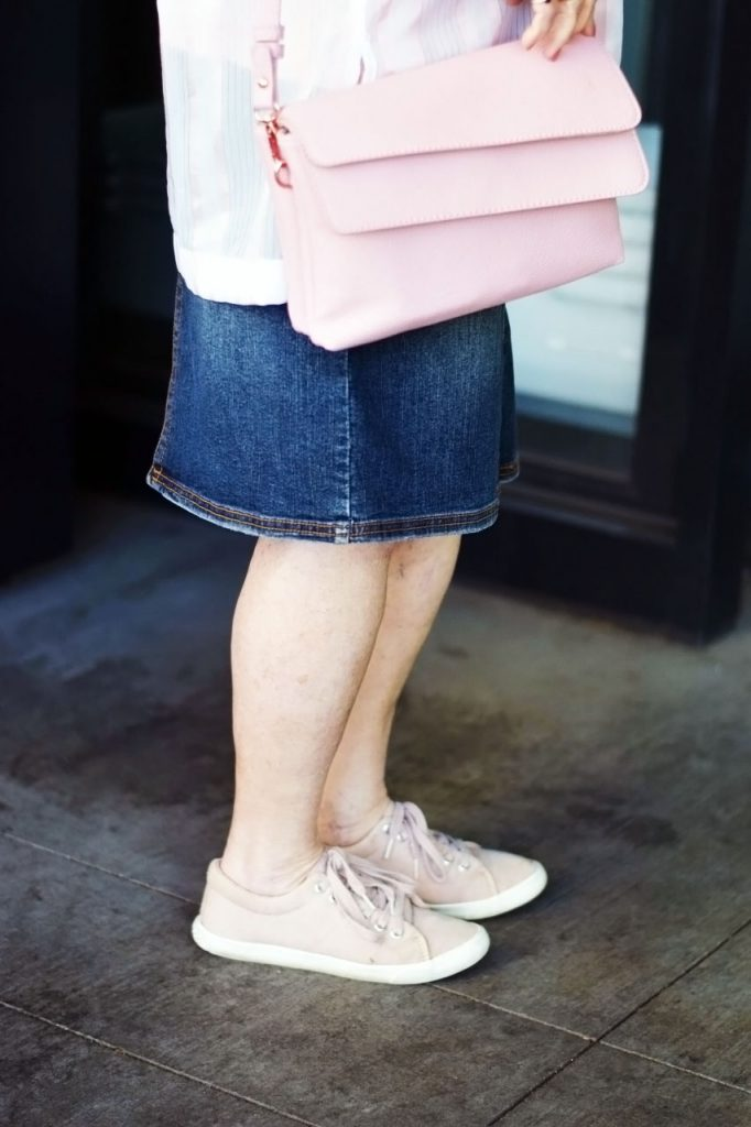 How to style a sheer pink top with a denim skirt & sneakers