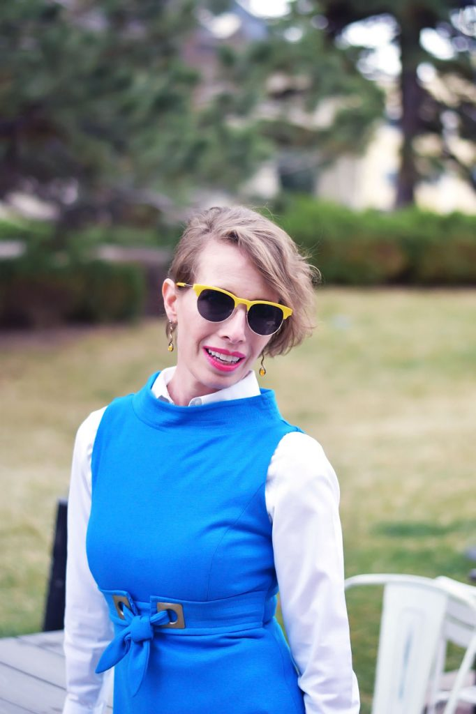 Wearing a Button Down Shirt under a dress with blue and yellow