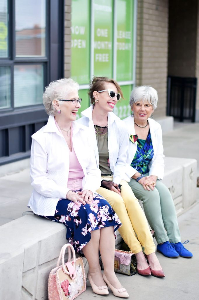White button down styled as a jacket for women over 40