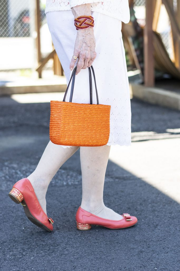 Wearing white in the summer with orange