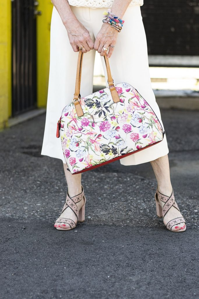 Wearing white in the summer with a floral purse