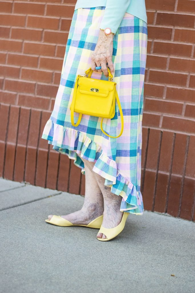 Wearing our class reunion outfits with a plaid skirt