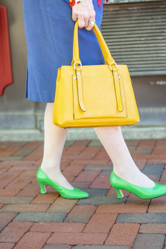 why you should wear Bright colors for summer with yellow purse