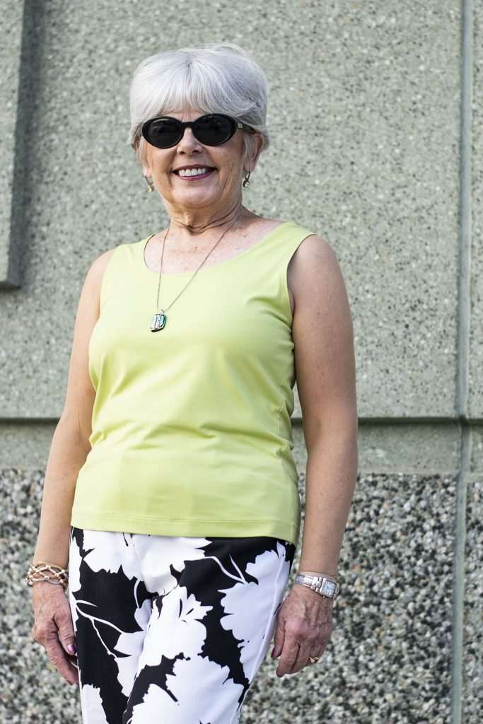 wearing sleeveless tops by covering your arms for women over 70