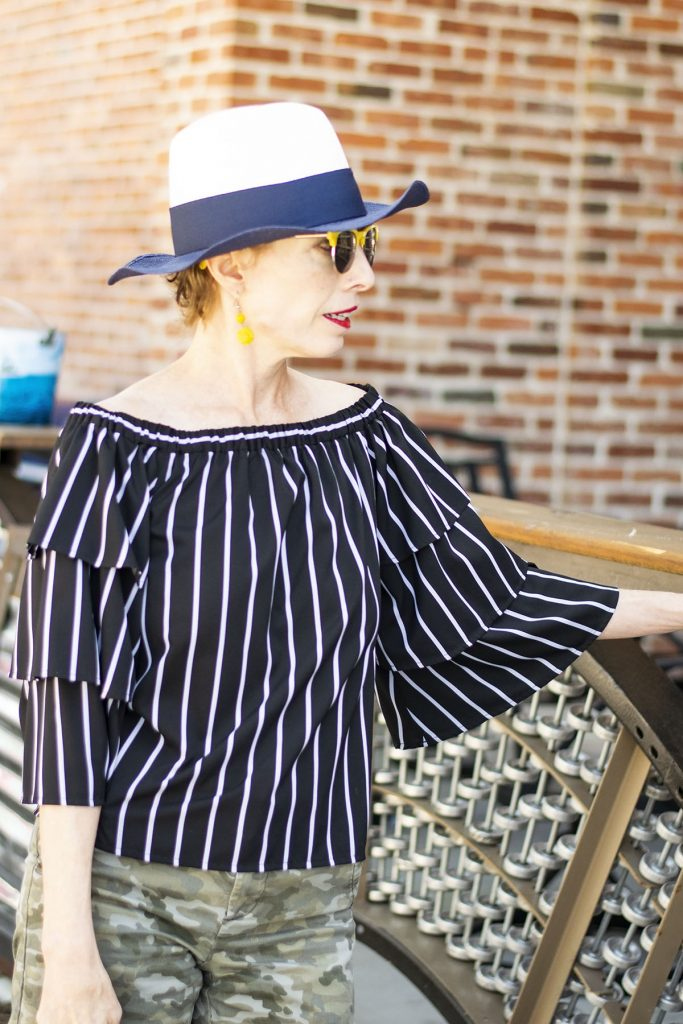 How to style camo outfits worn with black and white stripes