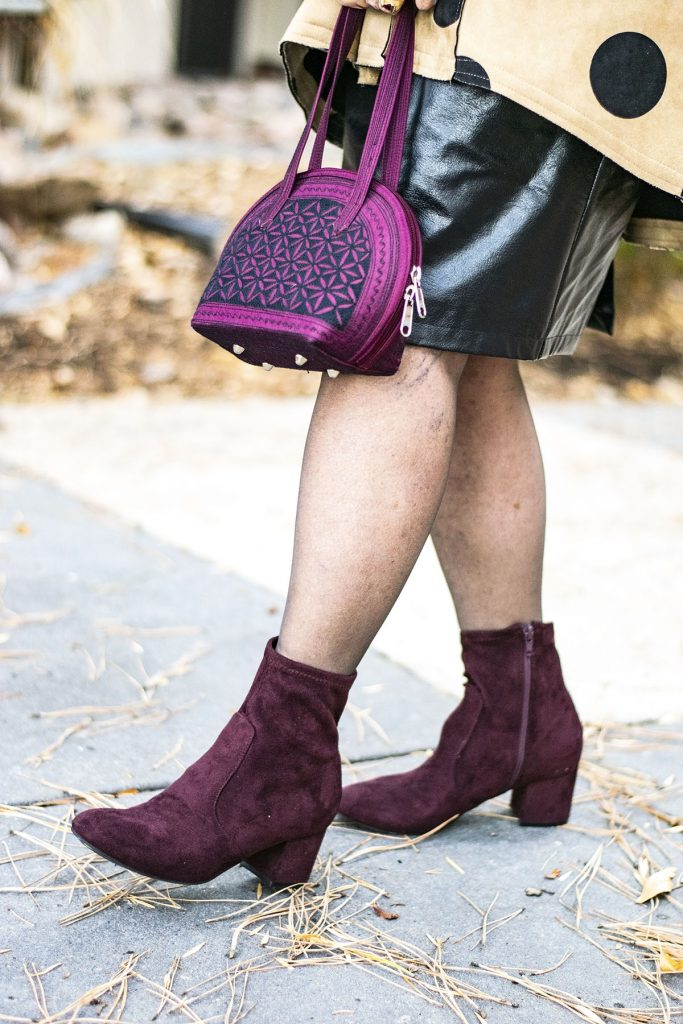 Black leather skirt outfit ideas with burgundy booties