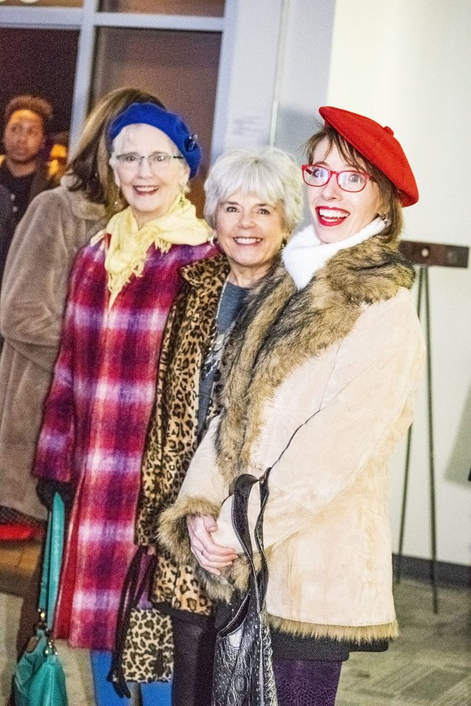 Women over 50 enjoying Denver Fashion week runway show with style