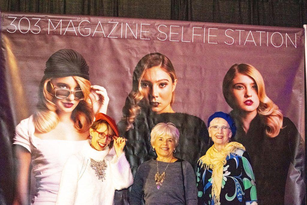 Women over 50 enjoying Denver Fashion week runway show in the fall