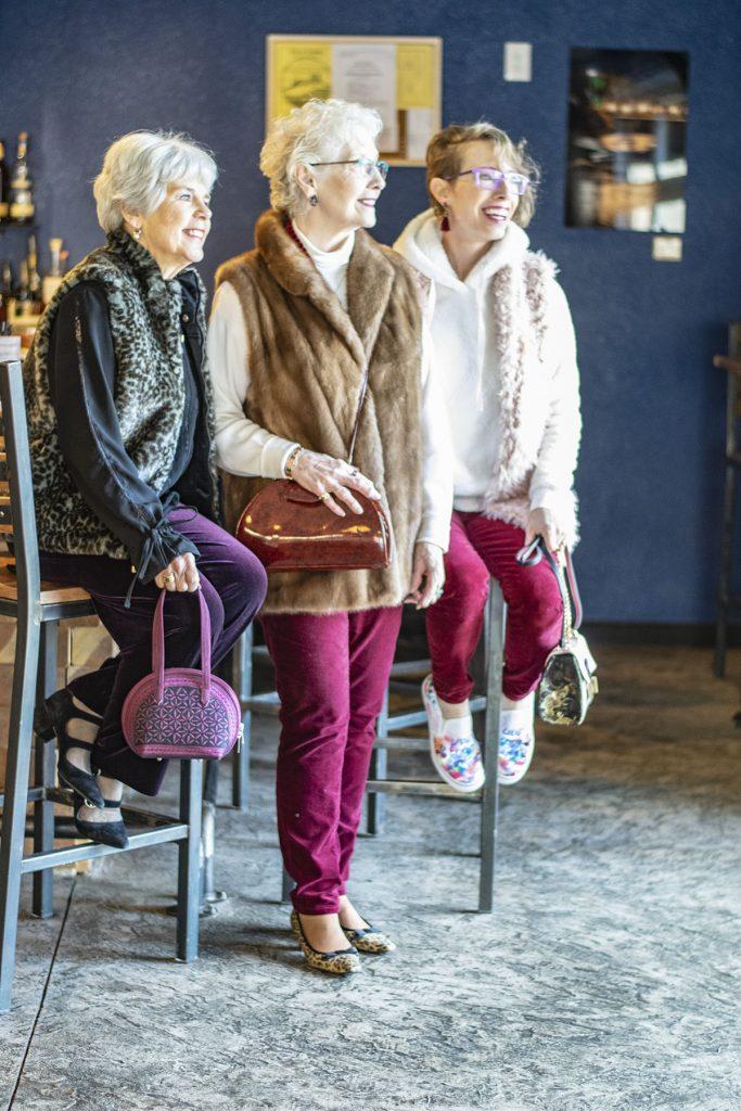 Styling velvet pants with fur vests for older ladies