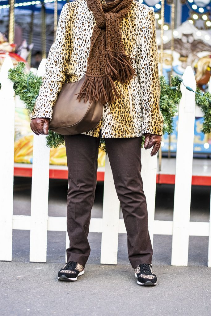 Wearing a leopard print coat with brown jeans