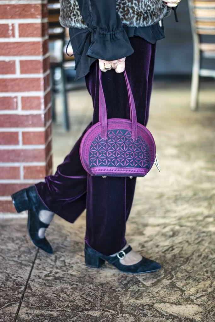 Styling burgundy velvet pants with black
