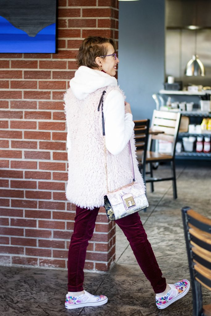 Styling velvet pants with a furry vest