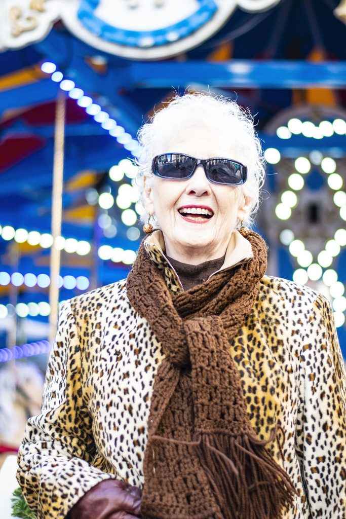 Wearing a leopard print coat with a brown scarf
