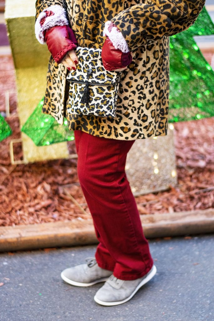 Wearing a leopard print coat with rust jeans