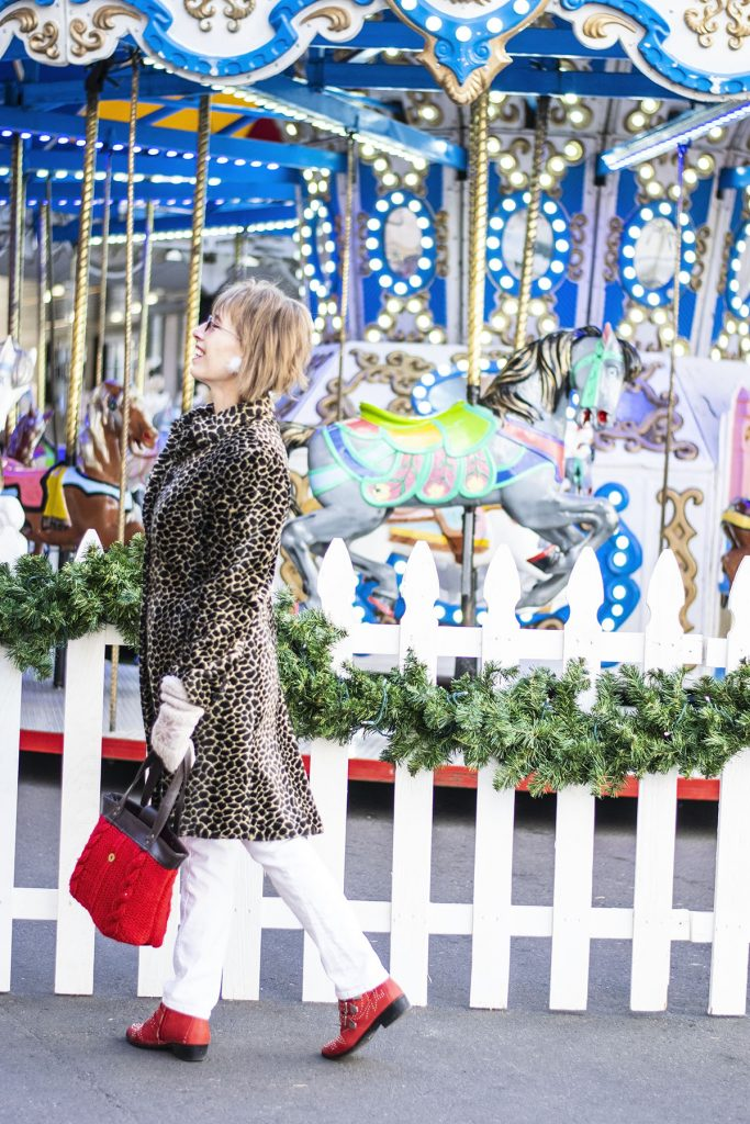 Wearing a leopard print coat with pops of red