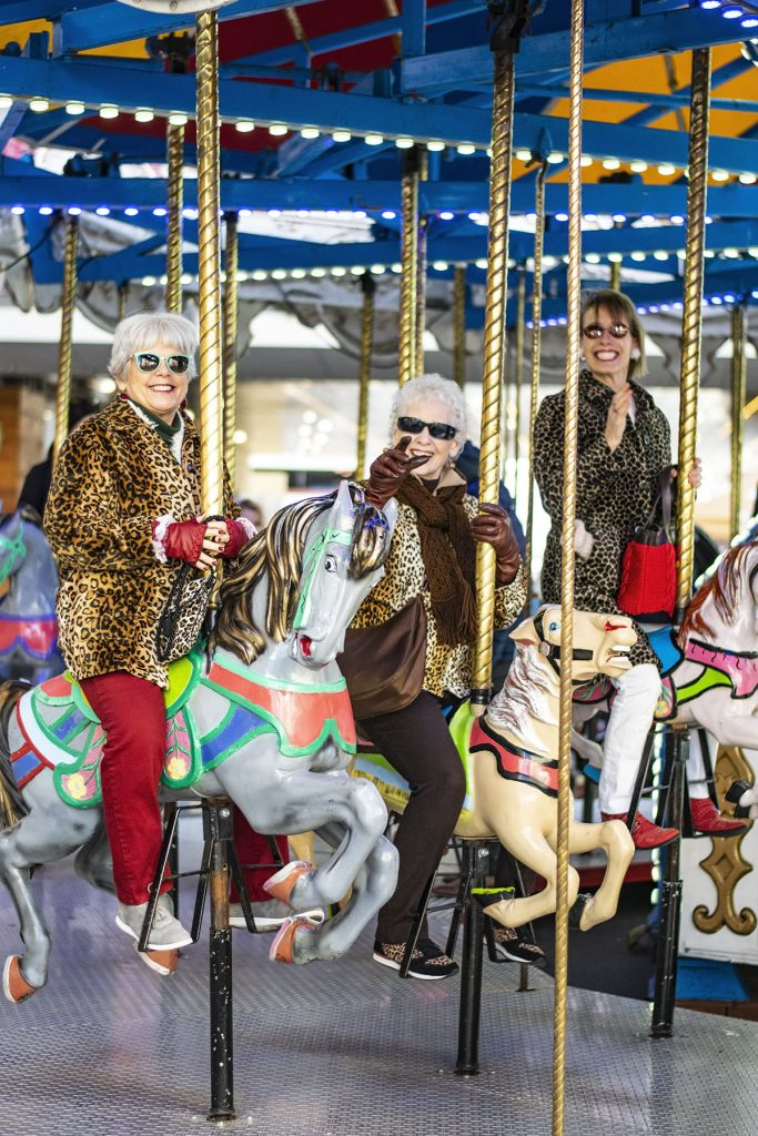 Wearing a leopard print coat for women on a carousel