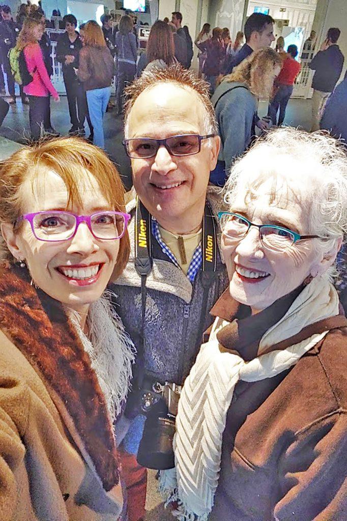 Men and women at the Dior exhibition in Denver, Colorado