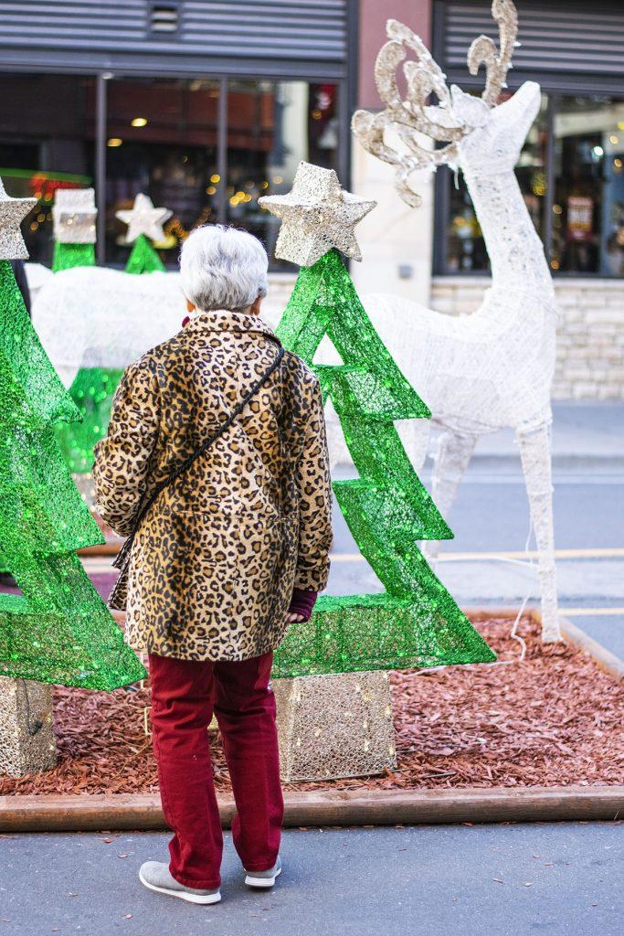Women over 60 styling a leopard print coat