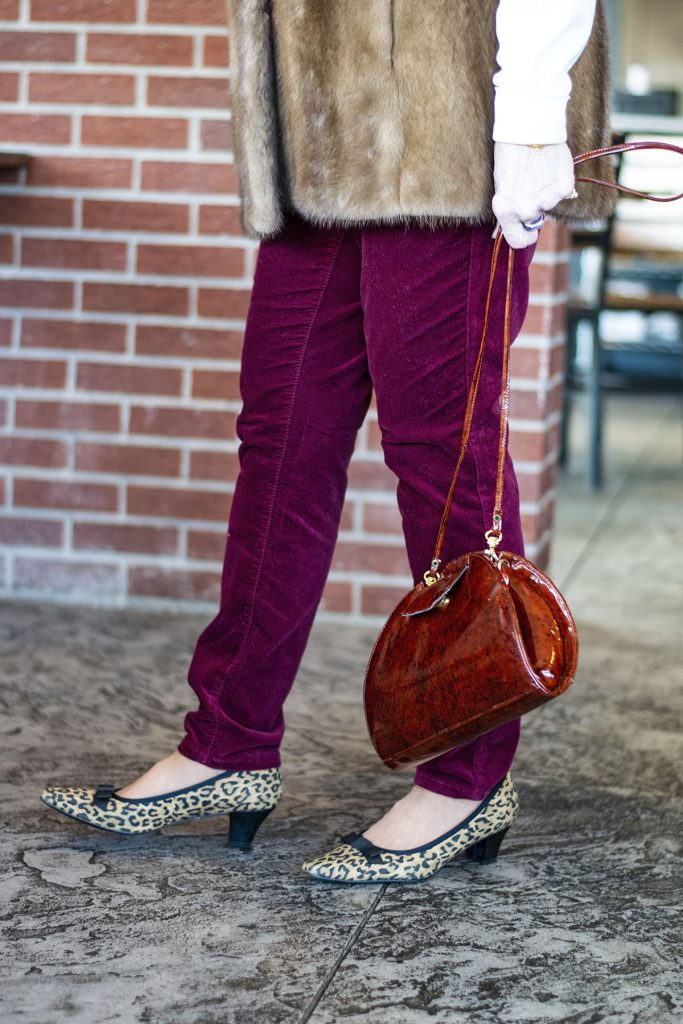Styling velvet pants with fur vests with leopard shoes