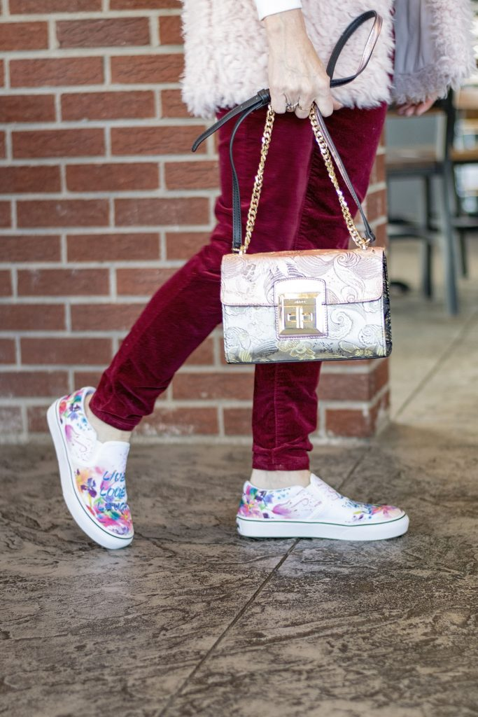 Styling velvet pants with fur vests with sneakers