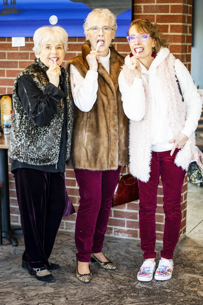 Styling velvet pants with fur vests for winter