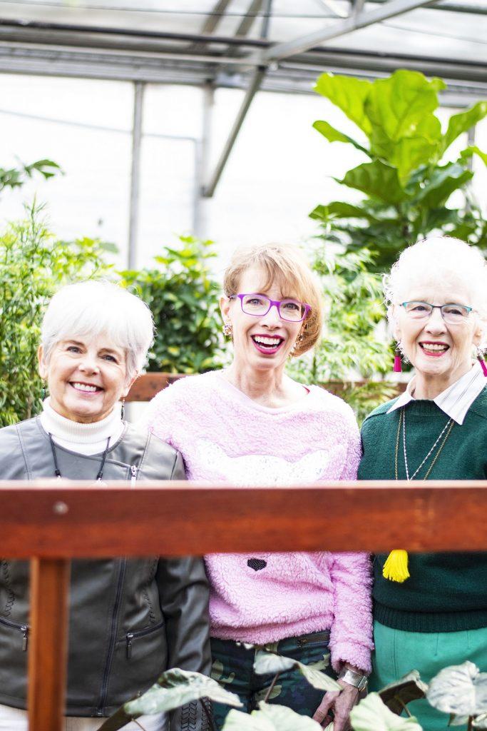 3 women wearing green in spring