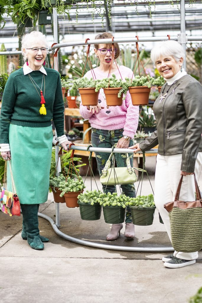 3 different ages of women wearing green