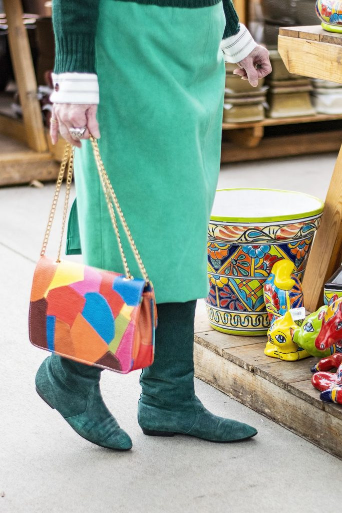 Wearing green with a colorful purse