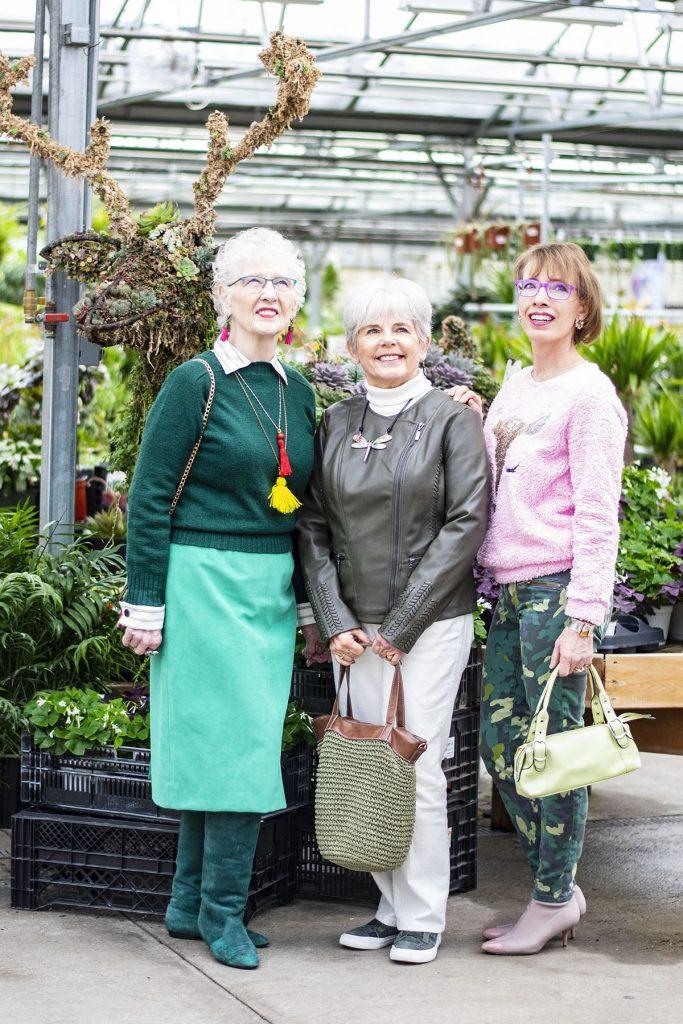 3 women wearing green different ways