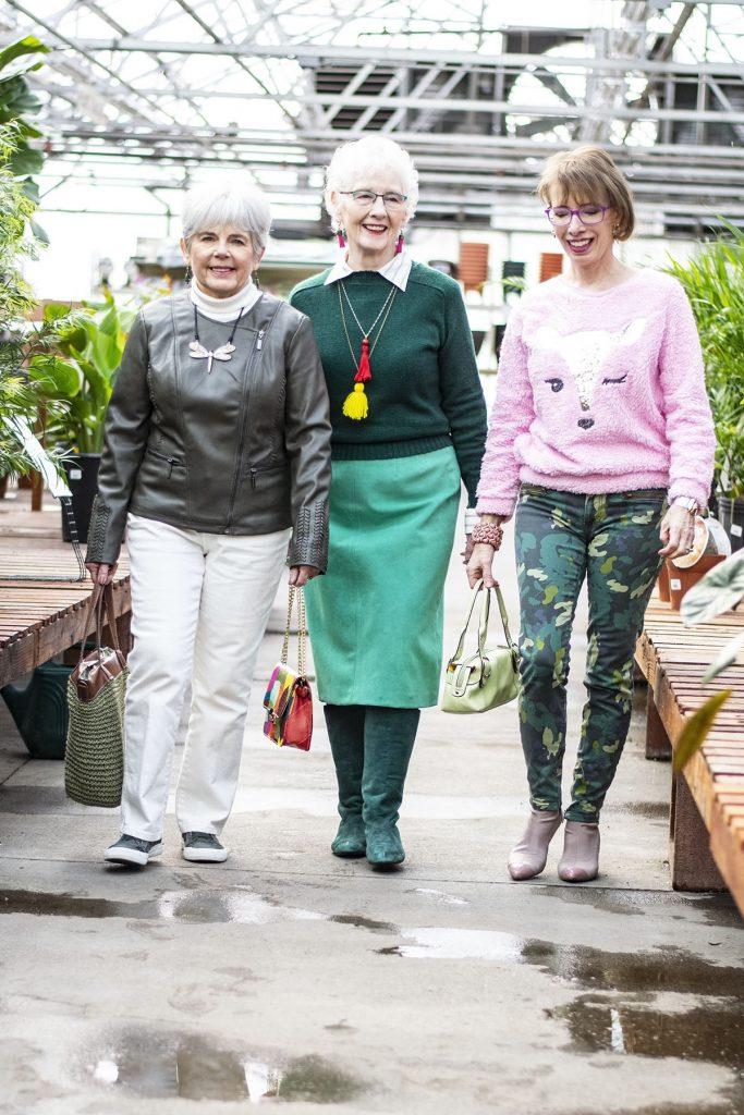3 women wearing green