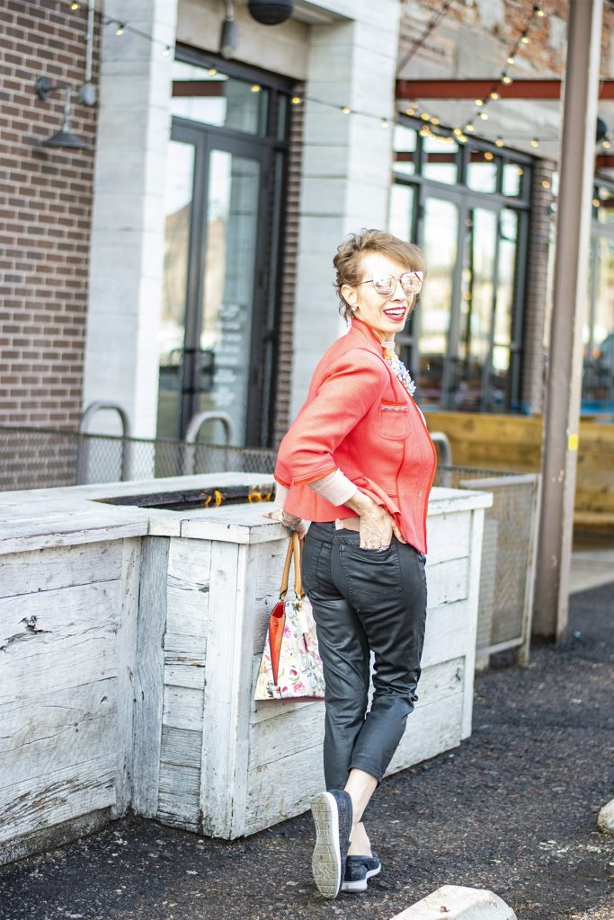 Styling spring colors with black jeans for women over 50