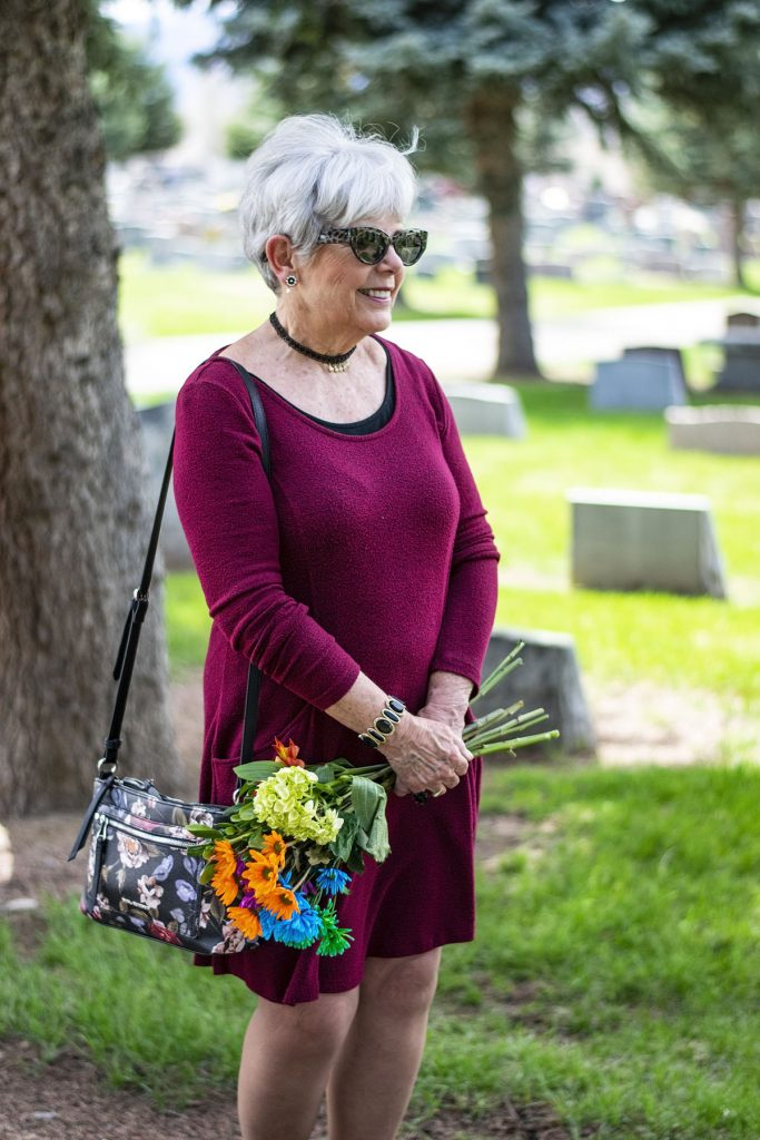 Woman over 70 at the cemetary