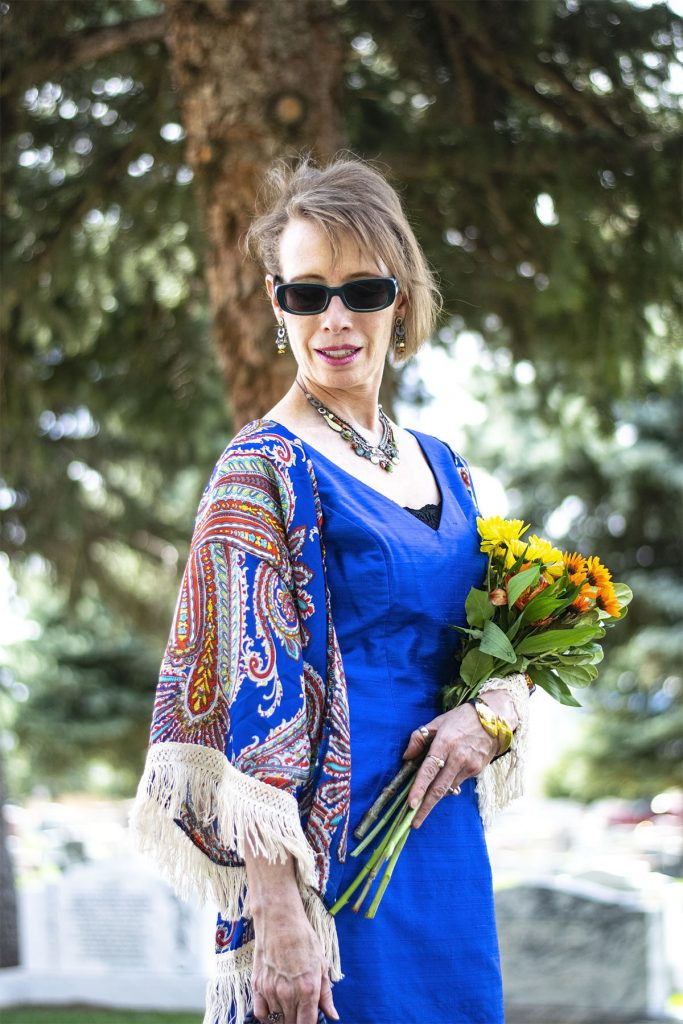 Woman over 50 wearing color to a funeral