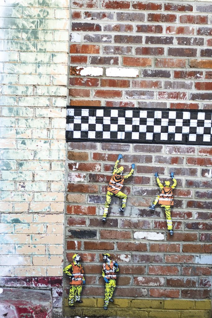 Murals on a brick wall
