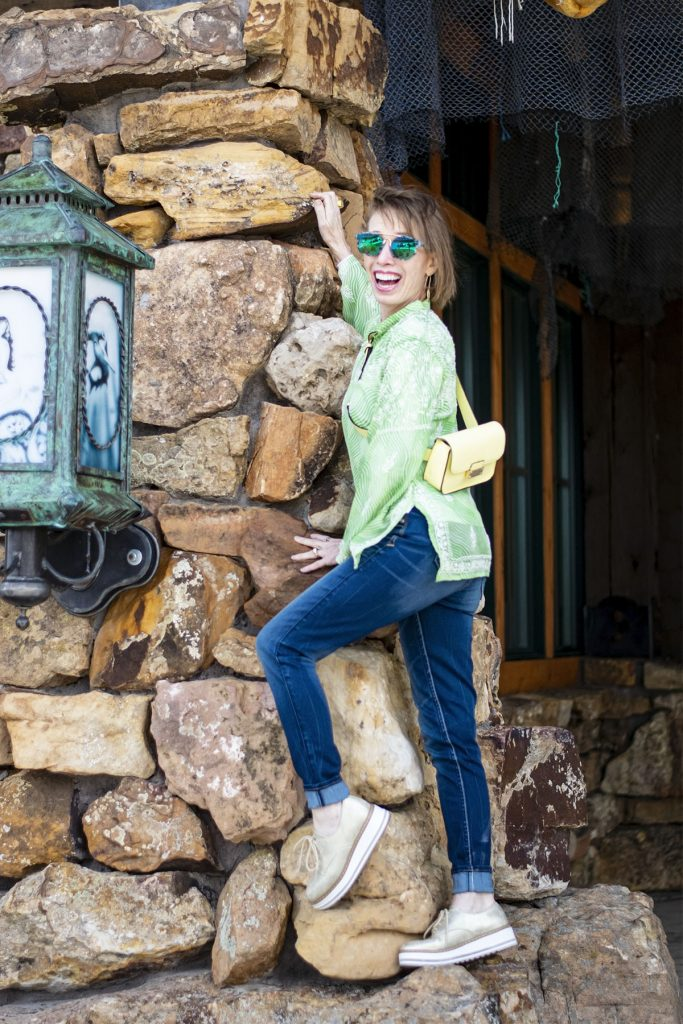 Styling a light lime green top with jeans