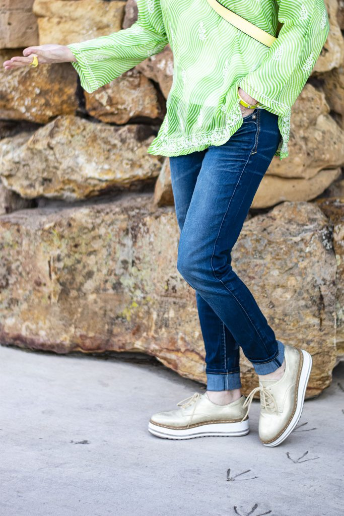 Gold flatforms with jeans