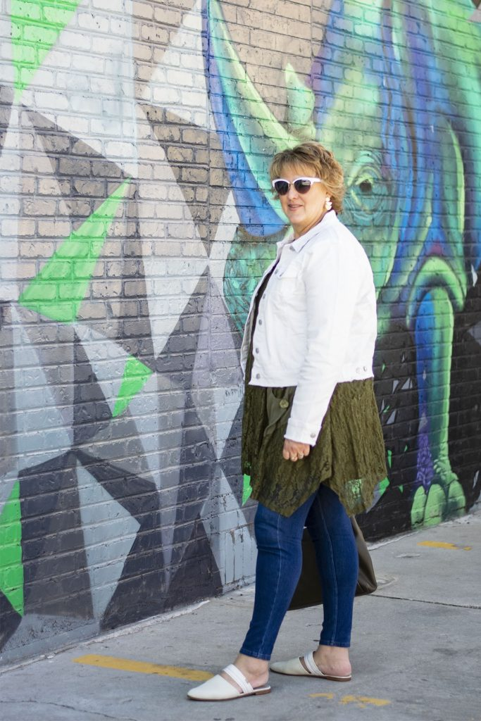 White denim jacket over a olive green tunic