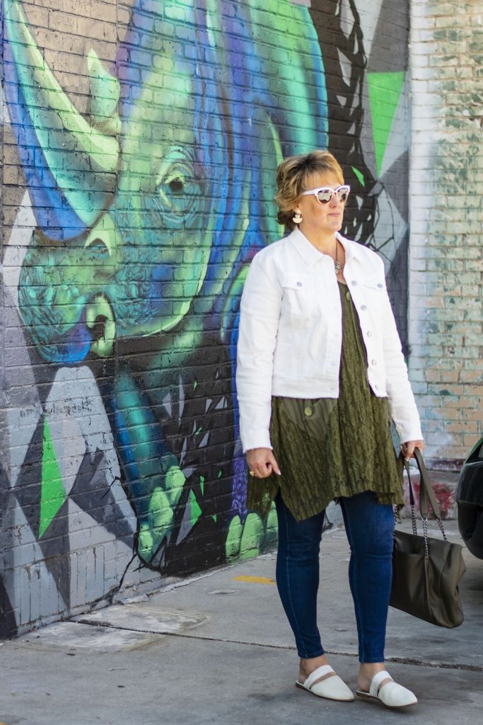 White denim jacket on a woman over 50