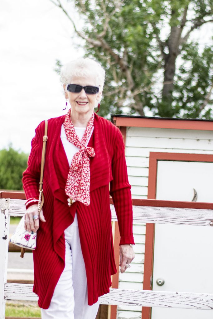 White pants red top for older woman